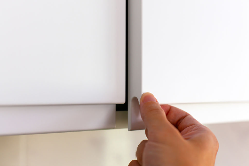 Check cupboard mechanisms and ensure doors align.